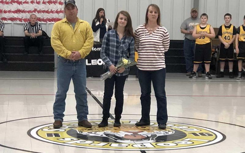 Strain-Japan eighth grade student, Keeley, and her parents.