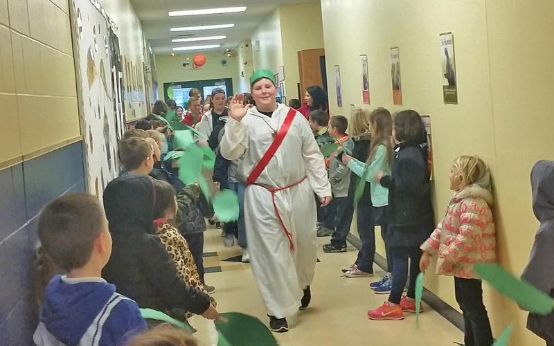 """ST. ANTHONY HALLS are filled with joyousshouts of """"Hosanna!"""" as they recreate Palm Sunday."""
