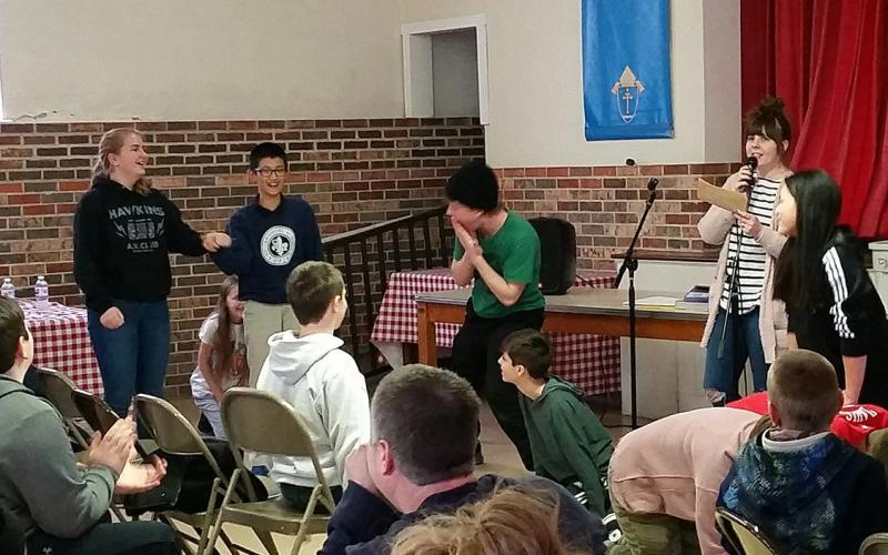 Students had a fun (though sometimes embarrassing) timeacting out a moralplay as it wasread by a REAP team leader. They were good sports and performed admirably!