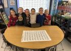 The kindergarten class proud that they were able to find 100 kisses that were hidden in their room.